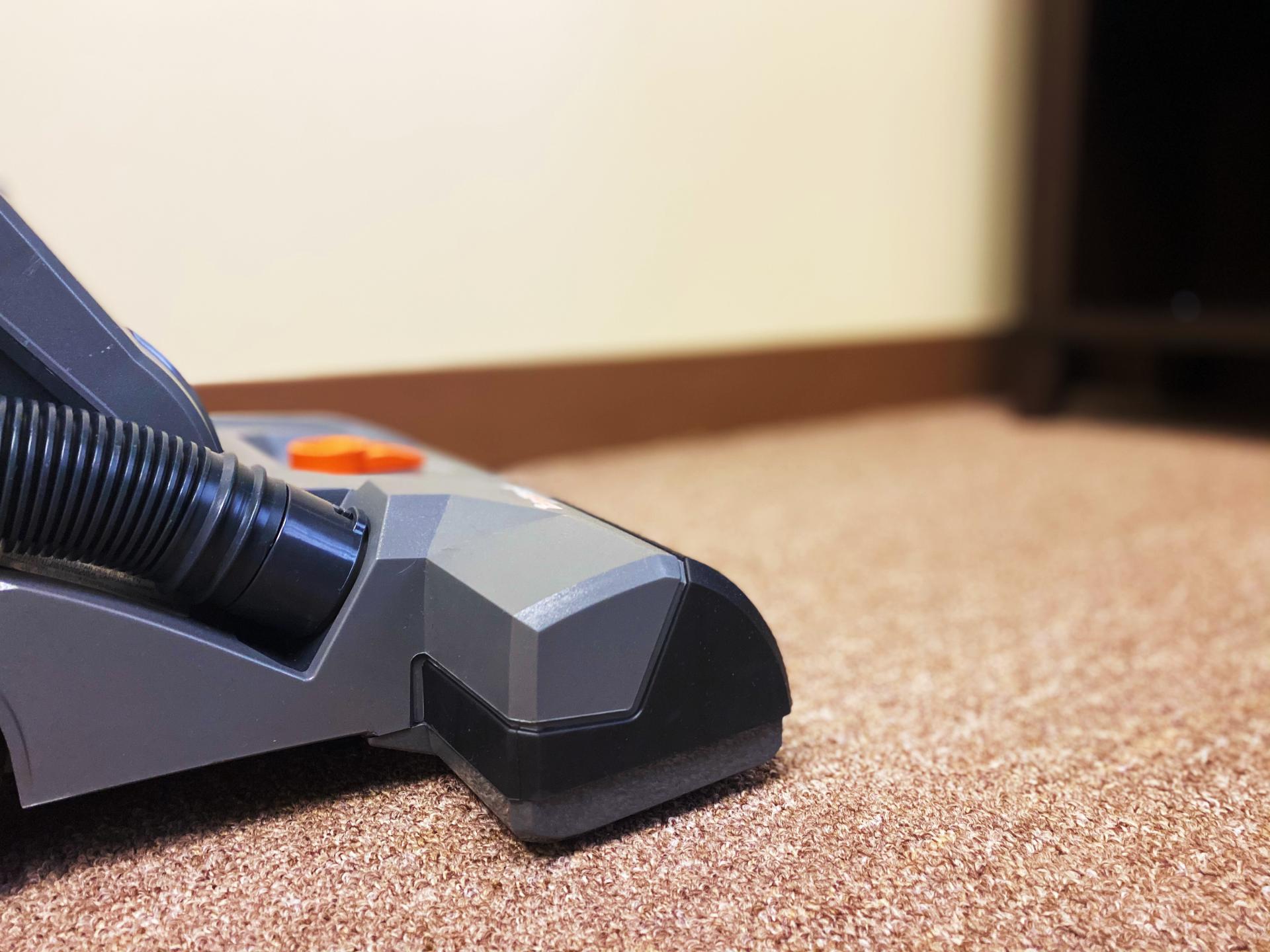 Vacuuming office carpet